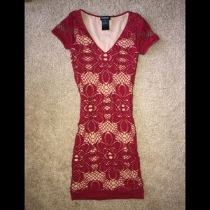 Small body hugging red lace Bebe dress
